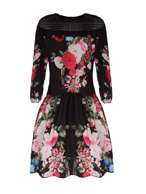 Elegancka sukienka z falbaną i najmodniejszym wzorem kwiatowym